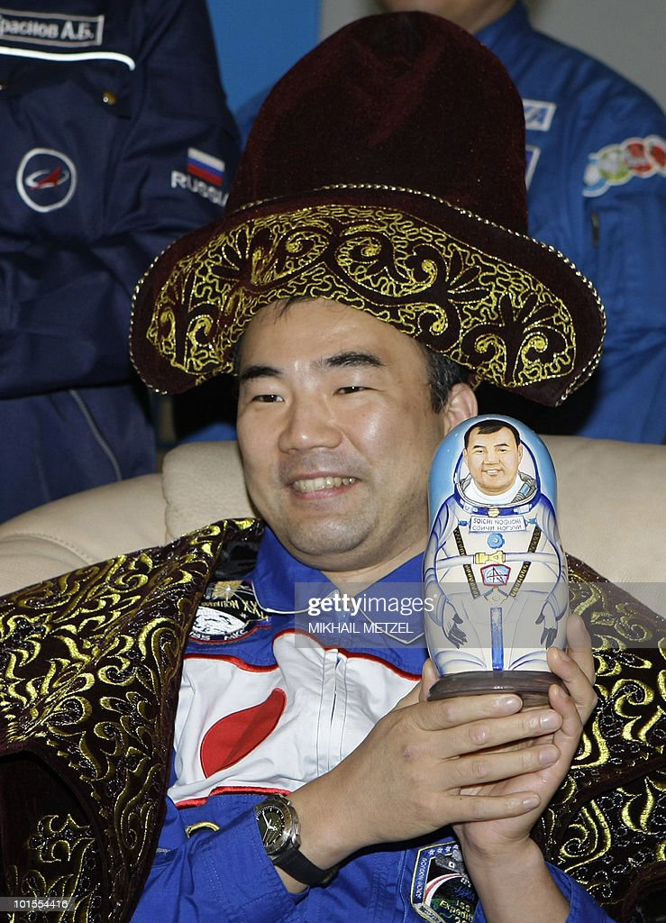 Japanese Aerospace Exploration Agency astronaut Soichi Noguchi wears traditional kazakh clothing at a press-conference at Karaganda airport in Kazakhstan on June 2, 2010. The Soyuz capsule, which carried the three astronauts safely returned to Earth after a half-year stint on the international space station, with a landing in the Kazakh steppe.