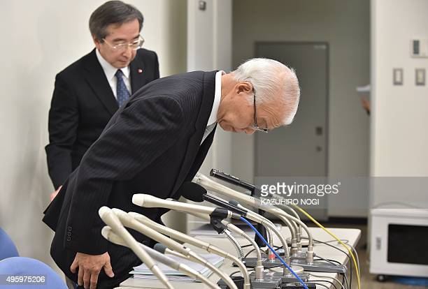 Japanese airbag supplier Takata Corp Chief Financial Officer Yoichiro Nomura bows before a press briefing to announce its financial results in Tokyo...