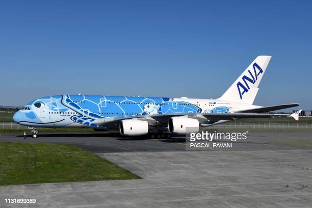 A Japanese airline All Nippon Airways ANA Airbus A380 is about to take off during a ceremony for the delivery of the company's first Airbus A380 on...
