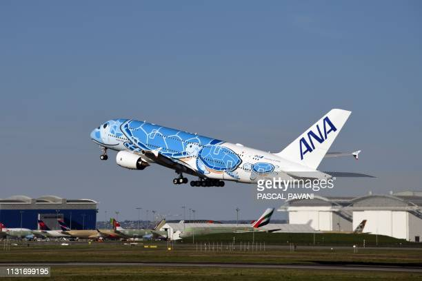 A Japanese airline All Nippon Airways ANA Airbus A380 takes off during a ceremony for the delivery of the company's first Airbus A380 on March 20...