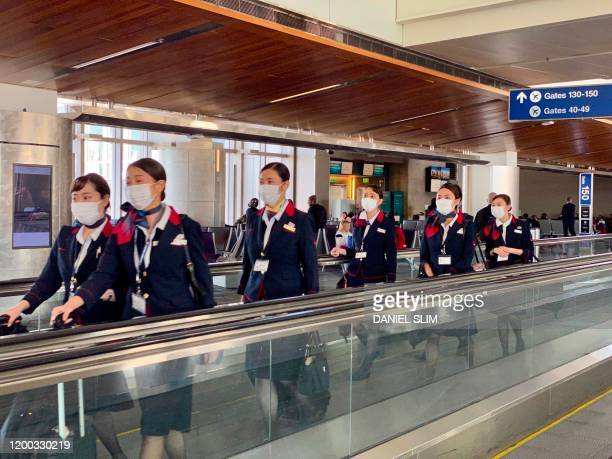 Japanese airline crew are seen at Los Angeles International Airport wearing masks to prevent the coronavirus infectionCOVID19 on February 12 2020 The...