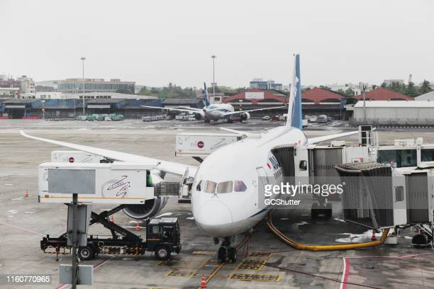 ana - japanese airline's flight getting ready at mumbai airport - commercial aircraft stock pictures, royalty-free photos & images