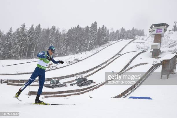 Japanese Akito Watabe competes during the individual Gundersen of the FIS Nordic Combined World Cup on January 20 2018 in ChauxNeuve eastern France /...