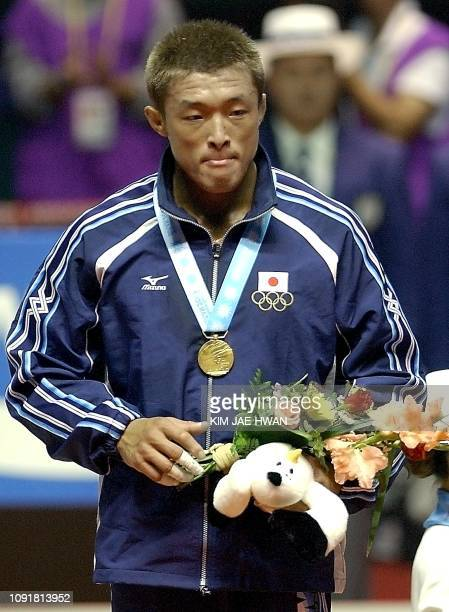 Japanese Akiyama Yoshihiro stand during the awarding ceremony for the Men's under81Kg final match of the 14th Asian Games in Busan 01 October 2002...