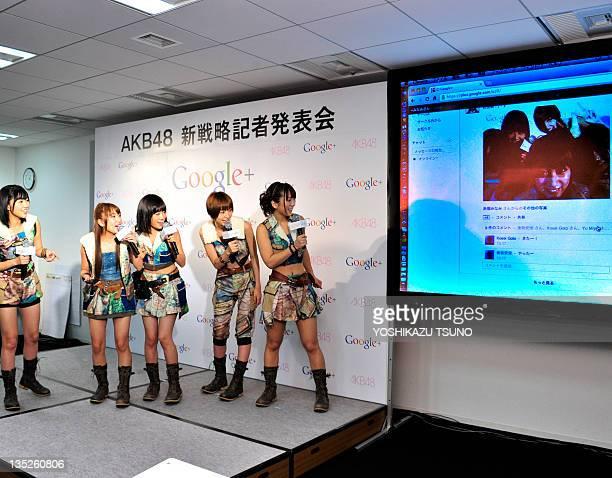 Japanese all-girl pop group AKB48 members Rino Sashihara, Minami Takahashi, Atsuko Maeda, Mariko Shinoda and Aki Takajo check their uploaded...