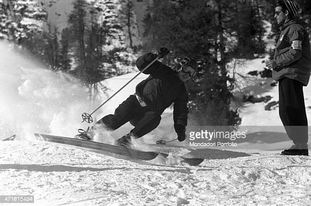 Japanese alpine ski racer Chiharu Igaya competing in the VII Olympic Winter Games training on the ski slope Cortina d'Ampezzo 1956