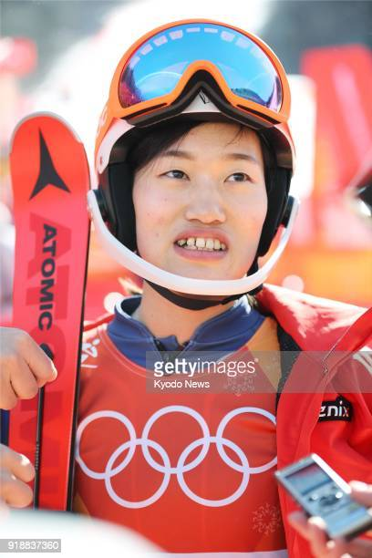 Japanese Alpine skier Asa Ando meets the press after failing to complete her first run in the women's slalom at the Pyeongchang Winter Olympics in...
