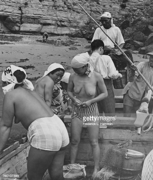 Japanese Ama divers preparing to put to sea where they will gather kelp Isumi District Chiba Japan circa 1960