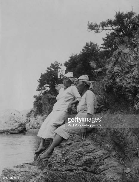 Japanese Ama pearl divers on Mikimoto Pearl Island in Ise Bay offshore Toba Mie Prefecture Japan where the women dive for cultured pearl oysters...