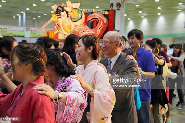Japanese Ambassador to South Korea Koro Bessho dances with participants during the 10th JapanKorea Festival at COEX on September 14 2014 in Seoul...