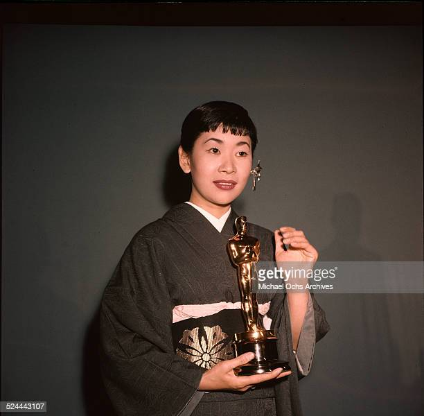 """Japanese American actress Miyoshi Umeki poses with her Academy Award for Best Supporting Actress in """"Sayonara"""" in Los Angeles,CA."""
