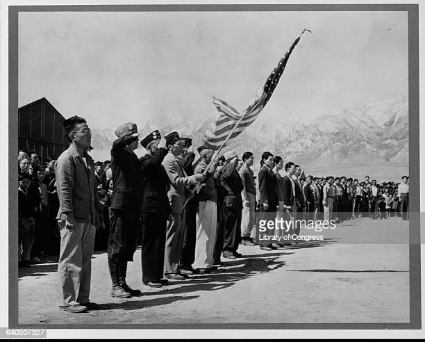 Japanese American Boy Scouts and American Legionaires hold Memorial Day services at the Manzanar Relocation Camp in California 1942 | Location...