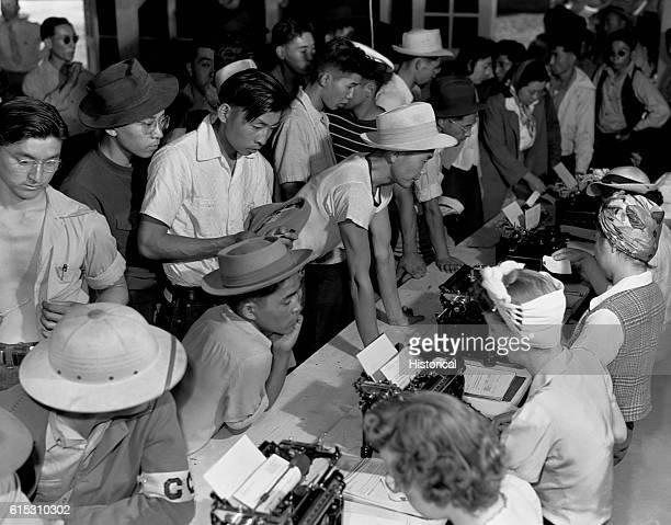 Japanese Americans deal with paperwork at an internment camp | Location in an internment camp