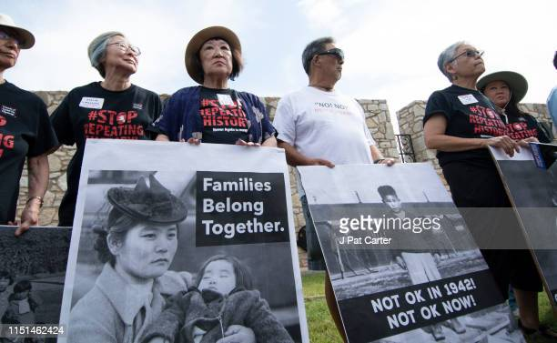 Japanese Americans pose with photos of themselves taken while they were in relocation camps in WWII during a press conference on June 22 2019 in...