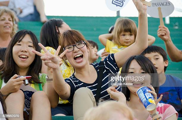 Japanese and Japanese American fans at a game in Chico California where Eri Yoshida the 19 year old female knuckleball pitcher from Japan pitched on...