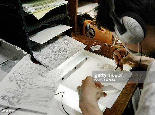 STORY 'LIFESTYLE JAPANFILMANIMATION' A Japanese animator draws animation pictures for a movie at a production in an apartment in Tokyo 05 June 2004...