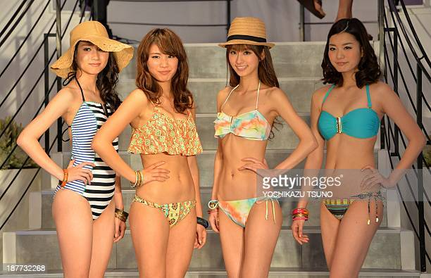 Japanese apparel maker Sanai's new campaign girl Ikumi Hisamatsu and models display the latest swimwears during Sanai's 2014 collection in Tokyo on...