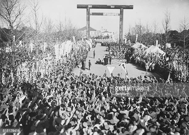 Japanese Approve League Stand Waving their hats and cheering loudly over thirty thousand Japanese Army reserves mass about the Yasukuni Shrine in...