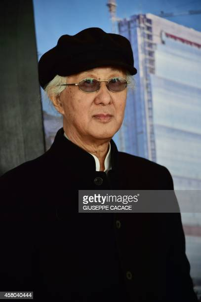 Japanese architect Arata Isozaki poses before a press conference at the City Life office Tower a skyscraper under construction in Milan on October 29...