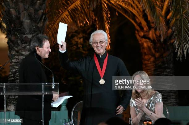 Japanese architect Arata Isozaki reacts as he is honoured after being awarded the 2019 Pritzker Architecture Prize at the Versailles Orangerie south...