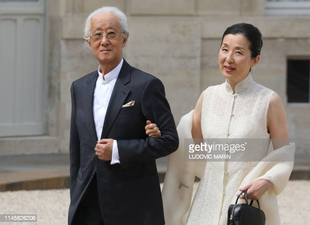 Japanese architect Arata Isozaki who has been awarded the Pritzker Prize arrives with his wife at the Elysee Palace in Paris to attend the 2019...