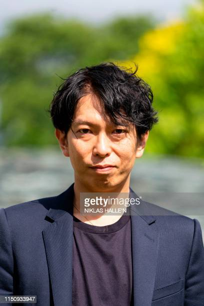 Japanese architect Junya Ishigami poses with his design for the 2019 Serpentine Pavilion at the Serpentine Galleries in London on June 20 2019