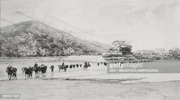 Japanese artillery fording the Yalu river ChinaNorth Korea RussoJapanese war photograph by Emerson from L'Illustrazione Italiana Year XXXI No 29 July...