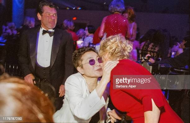 Japanese artist and musician Yoko Ono and American entertainer Bette Midler kiss one another on the cheeks during the 18th Annual CFDA Fashion...