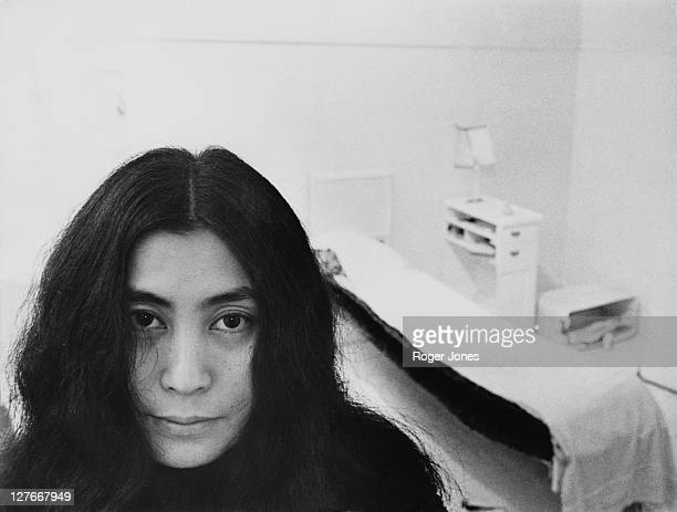 Japanese artist and musician Yoko Ono sits in a white-painted half bedroom entitled 'Half-a-Room', part of her recent avant-garde Half-a-Memory...
