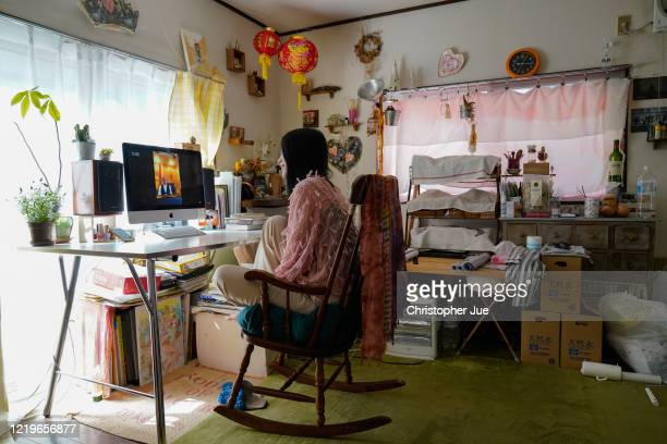 "Japanese artist Mika Tamori in her home studio watches the live stream performance of Paul McCartney during the ""One World: Together At Home""..."