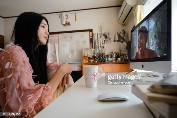 """Japanese artist Mika Tamori in her home studio watches the live stream performance of musician Lizzo during the """"One World: Together At Home""""..."""