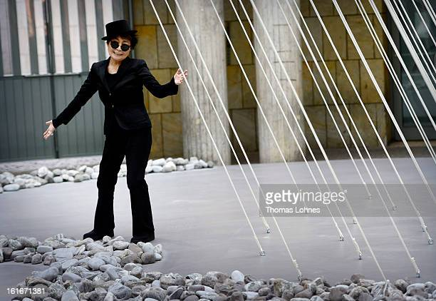 Japanese artist Yoko Ono poses alongside her artwork 'Morning Beams' and 'River Bed' at the Schirn Kunsthalle on February 14 2013 in Frankfurt am...