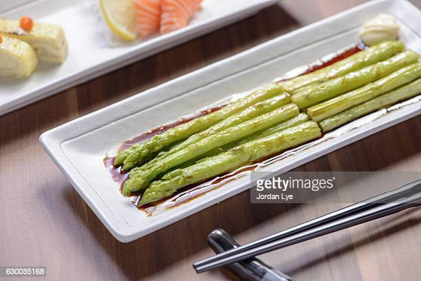 japanese asparagus meal - soy sauce stock photos and pictures