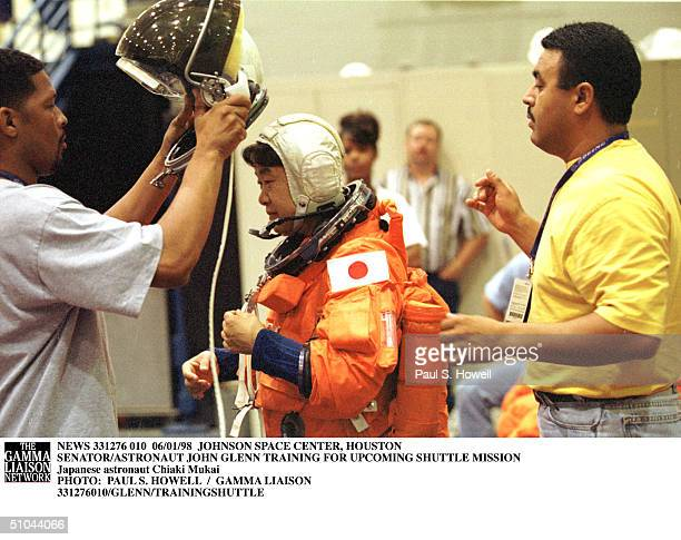 Japanese Astronaut Chiaki Mukai, Center, Is Helped Into Her Space Helmet By Nasa Technicians During Crew Escape Training Monday, June 1 At Nasa's...