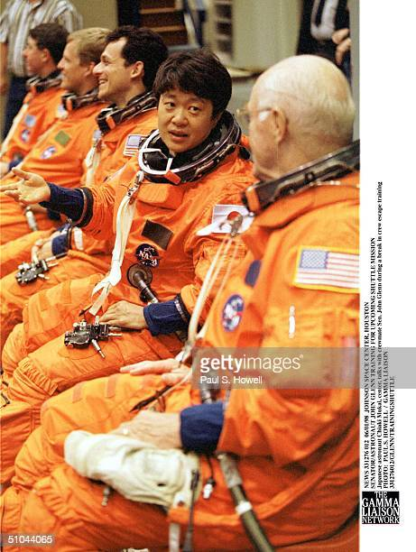 Japanese Astronaut Chiaki Mukai, Center, Talks With Crewmate Sen. John Glenn During A Break In Crew Escape Training Monday, June 1 At Nasa's Johnson...