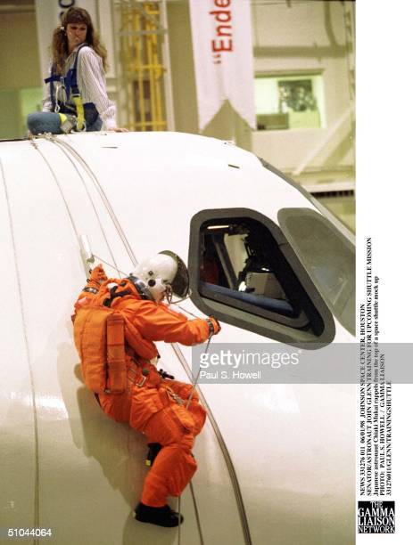 Japanese Astronaut Chiaki Mukai Rappels From The Top Of A Space Shuttle Mock Up With The Help Of Nasa Technician Sharon Jones During Crew Escape...