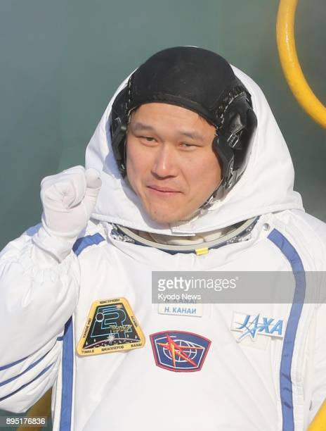 Japanese astronaut Norishige Kanai clenches his fist before boarding a Russian Soyuz spacecraft at the Baikonur Cosmodrome in Kazakhstan on Dec 17...