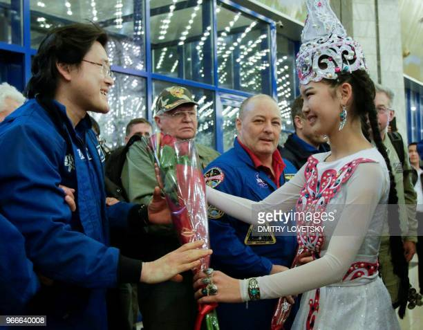 Japanese astronaut Norishige Kanai receives a bunch of flowers following the landing of the Russian Soyuz MS07 space capsule at Karaganda's airport...