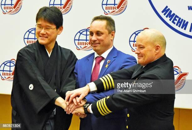 Japanese astronaut Norishige Kanai Russian cosmonaut Anton Shkaplerov and US astronaut Scott Tingle attend the ISS Expedition 54/55 crew members...