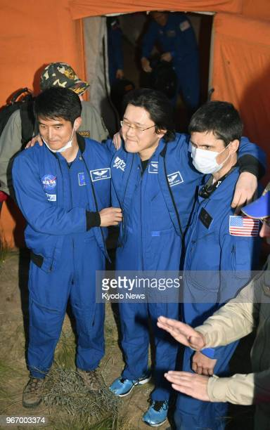 Japanese astronaut Norishige Kanai stands with support of staff in Kazakhstan on June 3 after undergoing a medical checkup at a tent seen in the...