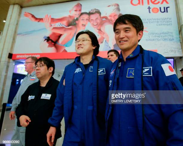 Japanese astronaut Norishige Kanai walks with Japanese rescue team after landing in the Russian Soyuz MS07 space capsule at Karaganda's airport on...