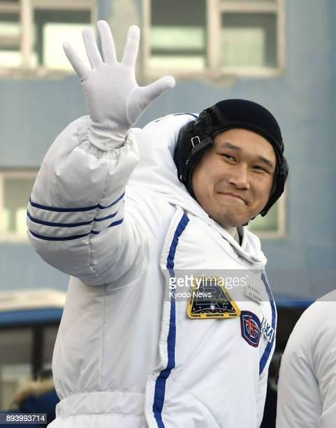 Japanese astronaut Norishige Kanai waves before boarding a Soyuz spacecraft in Baikonur Kazakhstan on Dec 17 2017 ==Kyodo