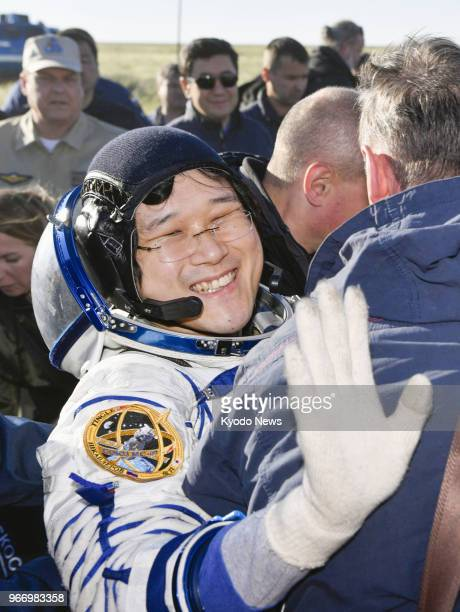 Japanese astronaut Norishige Kanai waves his hand after landing in the Kazakhstan countryside with two other crew members from the International...