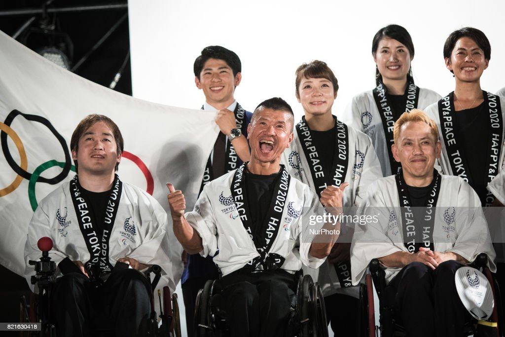 Japanese athletes posses for photos during the Tokyo 2020 flag tour festival for the 2020 Games at Tokyo Metropolitan Plaza in Tokyo, July 24, 2017. Japan began its three-year countdown for the Tokyo 2020 Summer Olympics in Tokyo on Monday with image projection-mapping beamed on a building of Tokyo Metropolitan Government Office. The 2020 Games will be Japan's first summer Olympics since the 1964.