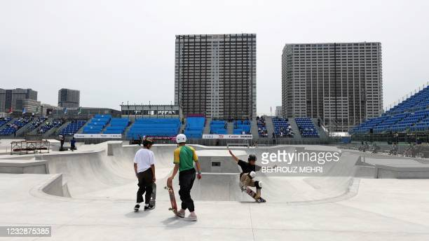 Japanese athletes warm up in the the skateboarding park category during skatebording test event for Tokyo 2020 Olympic Games at the Ariake Urban...