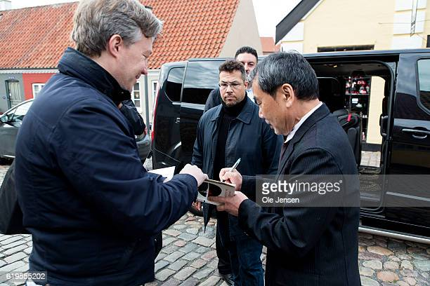 Japanese author Haruki Murakami gives a fan an autograph outside the house of Danish author Hans Christian Anderson prior to Murakami's receival of...