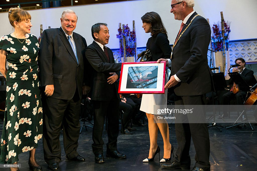 Japanese author Haruki Murakami (C) receives The Hans Christian Anderson Literature award presented by Crown Princess Mary (R, 2nd) at Odense City Hall on October 30, 2016, in Denmark. The prize was a bronze statue depicting Hans Christian Anderson's 'The Ugly Duckling' and DKK 500.000 (EUR 57.000).
