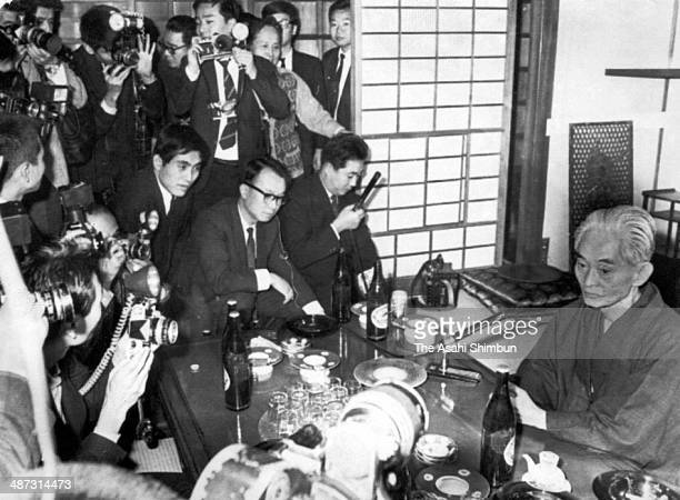 Japanese author Yasunari Kawabata is surrounded by media reporters as he awarded the Nobel Prize at his home on October 17 1968 in Kamakura Kanagawa...