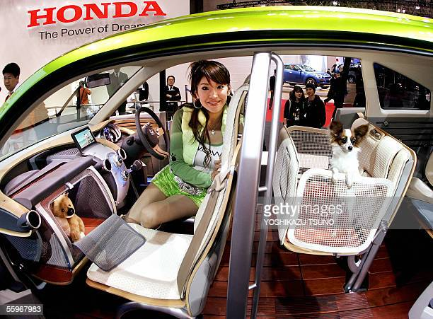 Japanese auto giant Honda displays a dog friendly concept vehicle WOW which has dog cages between the front and rear and a basket in the instrument...