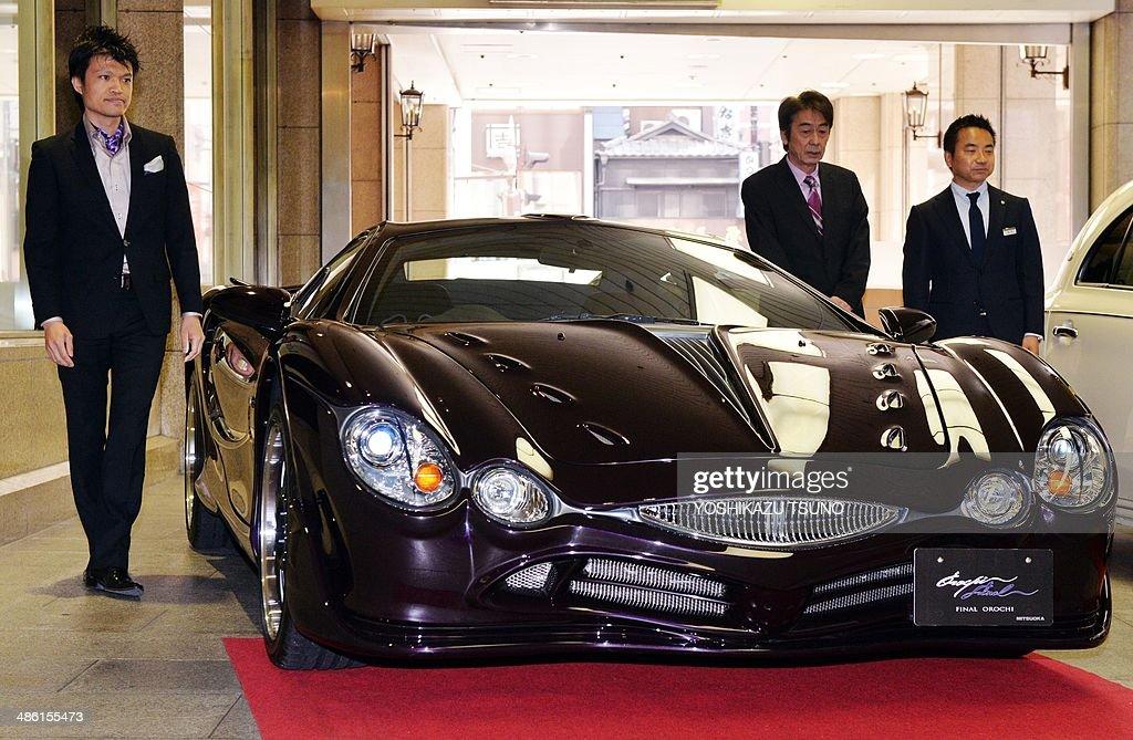 Japanese Auto Maker Mitsuoka Motor President Akio Mitsuoka (C) And Designer  Takanori Aoki (